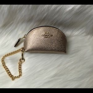 NWT- coach hand bag mini half moon gold rose color